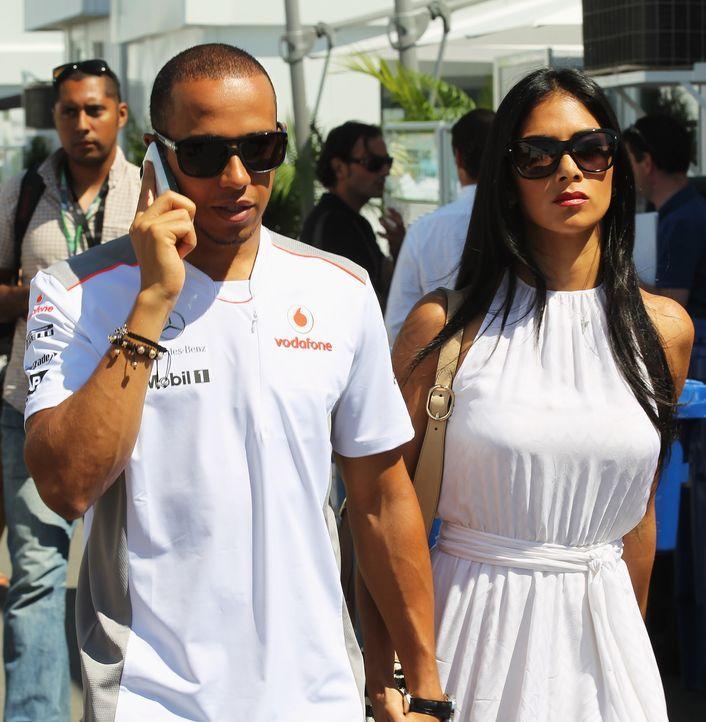Nicole Scherzinger und Lewis Hamilton - Bildquelle: AFP