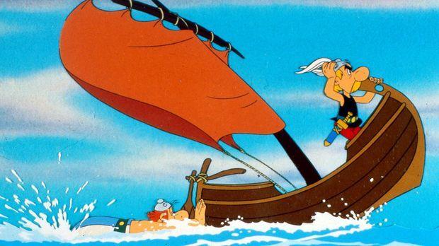 Obelix (l.) betätigt sich als Außenbordmotor, während Asterix (r.) den  Kurs...