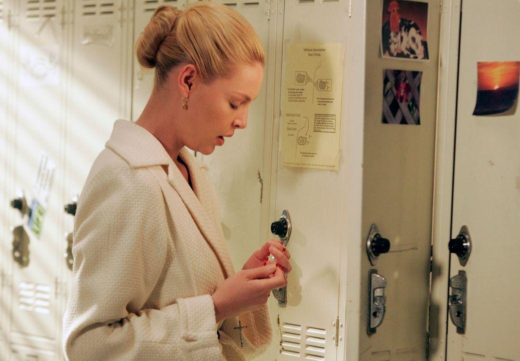 Izzie (Katherine Heigl) kämpft mit ihrer Vergangenheit, als plötzlich ihre leibliche Tochter und deren Adoptiveltern im Krankenhaus erscheinen ... - Bildquelle: Touchstone Television