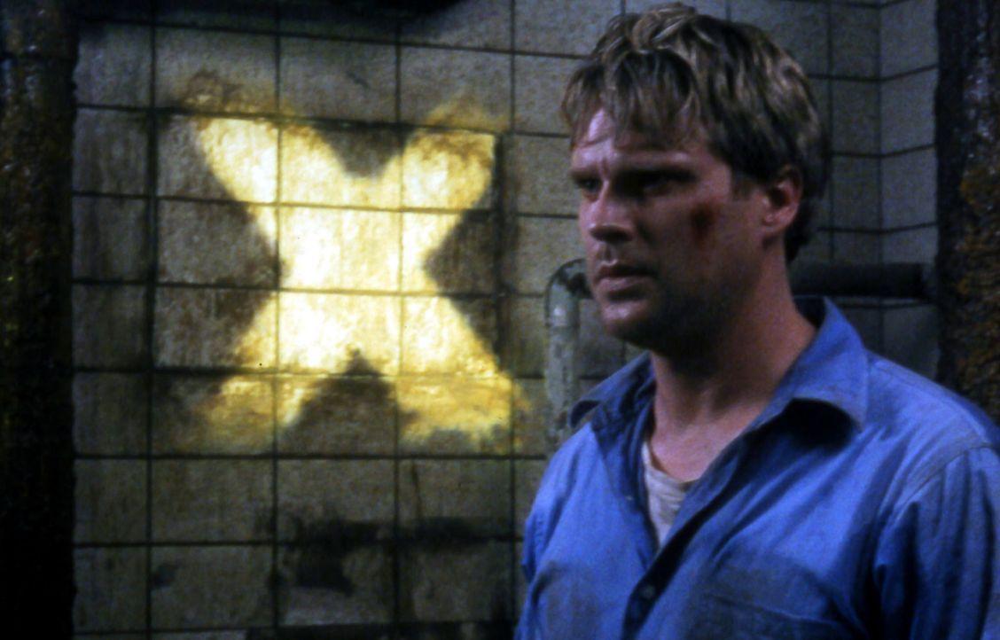 Eines Tages erwacht der Chirurg Lawrence Gordon (Cary Elwes) in einem schrecklichen Alptraum. Er ist mit schweren Ketten an der Wand einer dreckigen... - Bildquelle: Twisted Pictures