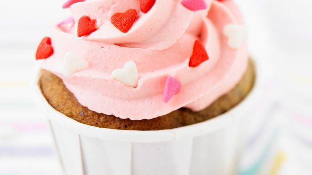 Leckere Himbeercupcakes mit rosa Frosting
