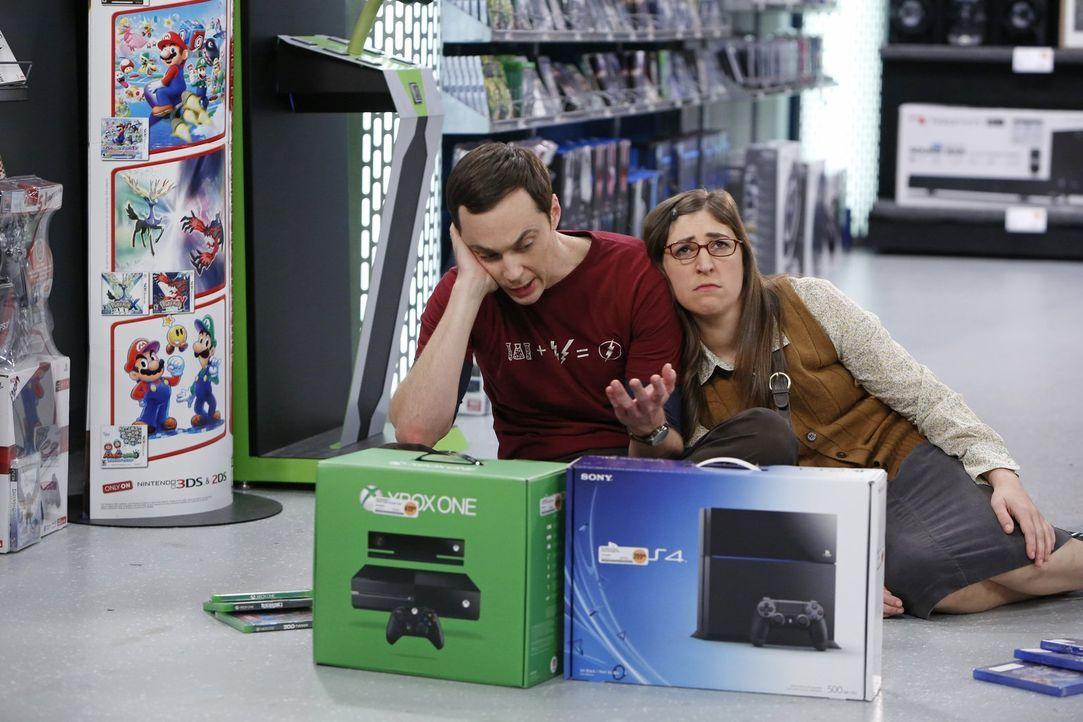 Sheldon (Jim Parsons, l.) bringt Amy (Mayim Bialik, r.) an den Rand der Verzweiflung, als er sich nicht zwischen zwei Spielsystemen entscheiden kann... - Bildquelle: Warner Brothers