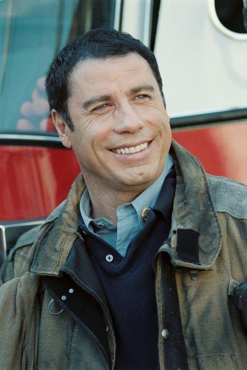 Captain Mike Kennedy (John Travolta) lässt nichts unversucht, Jack zu retten - und setzt dabei das eigene und das Leben seiner Männer aufs Spiel ... - Bildquelle: Buena Vista International.  All Rights Reserved