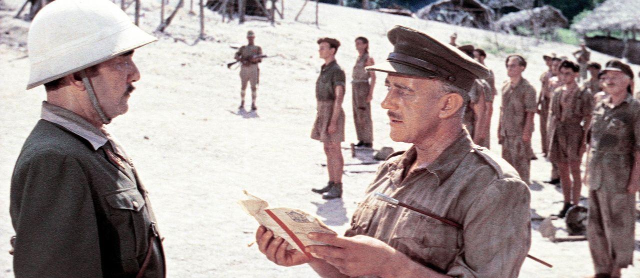Selbst im Kriegsgefangenenlager lässt sich der eiserne Wille von Oberst Nicholson (Alec Guinness, r.) nicht brechen, was den Lagerkommandant Saito...