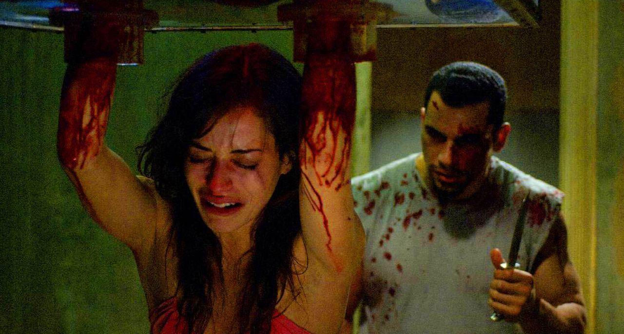 In der Gewalt eines Wahnsinnigen: Addison (Emmanuelle Vaugier, l.) und  Xavier (Franky G., r.) ... - Bildquelle: Kinowelt Filmverleih