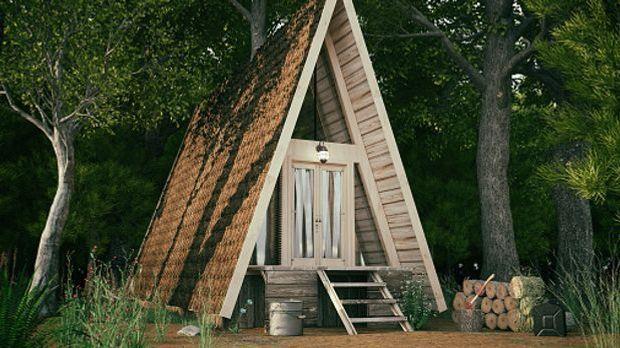 Tiny House mit spitzem Dach im Wald