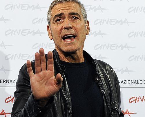 Galerie: George Clooney & Elisabetta Canalis - Bella Figura - Bildquelle: AFP