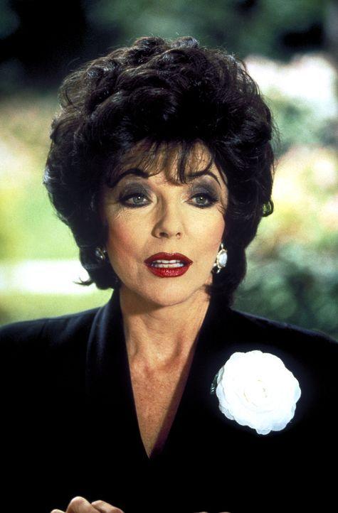 Liebe macht blind: Die wohlhabende Autorin Camilla Ashley (Joan Collins) bemerkt nicht, dass es ihr neuer Ehemann nicht sonderlich ernst mit ihr mei... - Bildquelle: Columbia Pictures